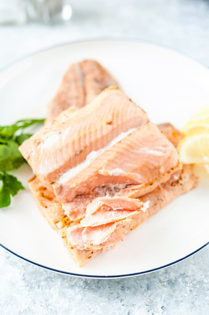 Poached Salmon on a plate, flaked.