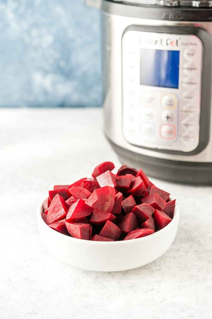 Bowl full of beets cooked in Instant Pot.