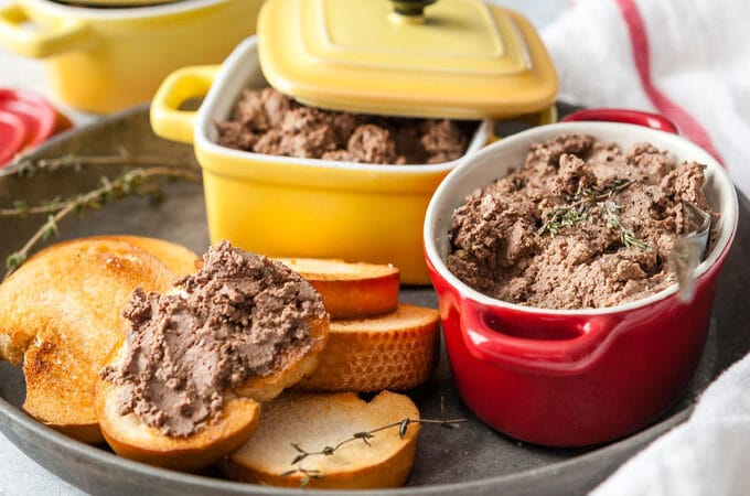 Bowl with Instant Pot Chopped Liver and toast with it.