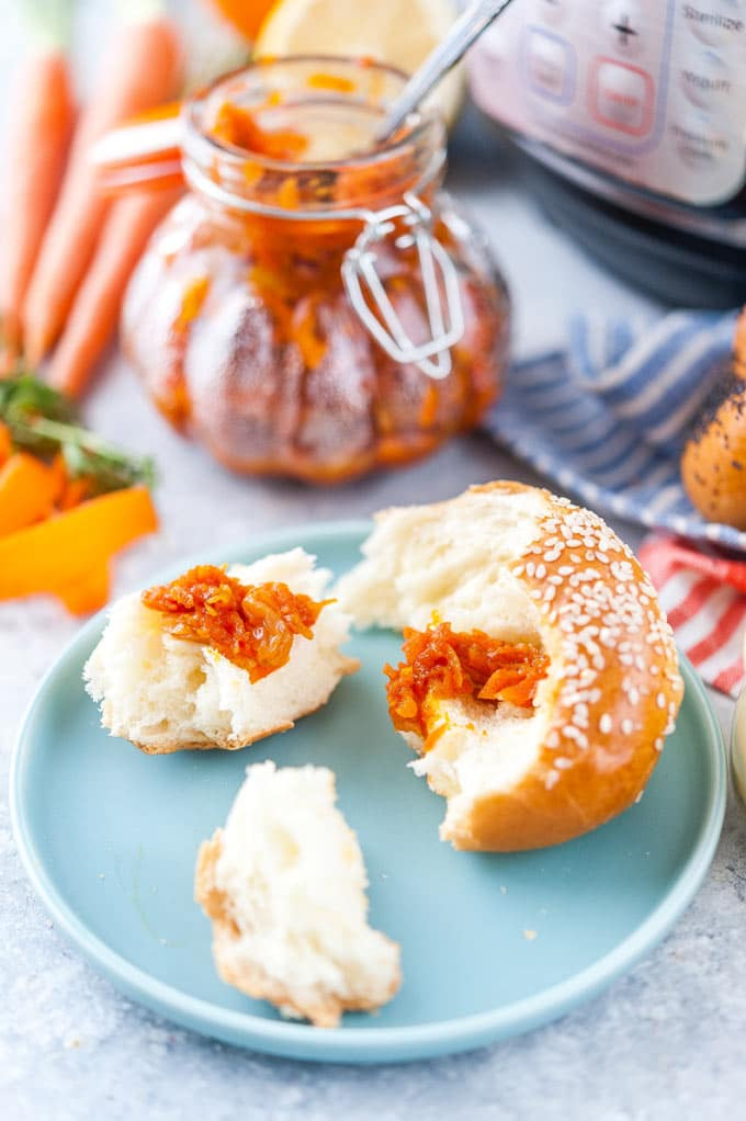 Soft roll with a bit of carrot jam on top of it.