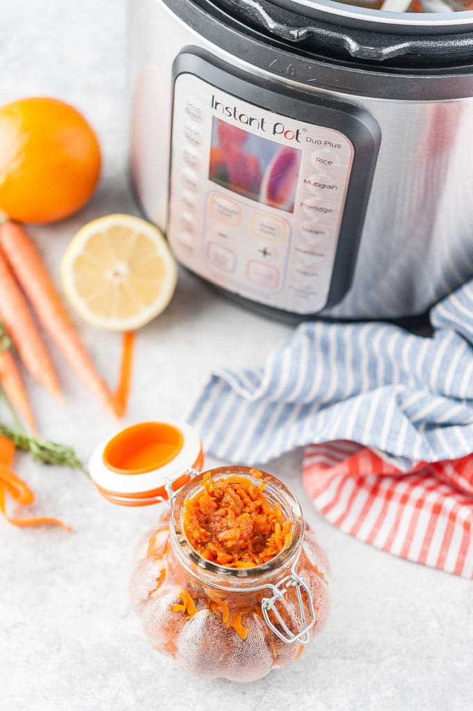 Jar with Carrot Cake Jam and Instant Pot in the background.