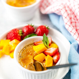Spoon in a bowl with creme brulee.